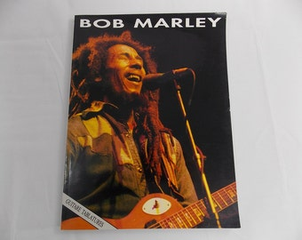 Bob Marley music notes book guitar tablatures reggae songs from 1992 like new  with songs like No Woman No Cry Jamming Three little birds