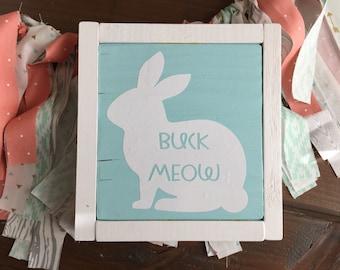 Buck meow sign