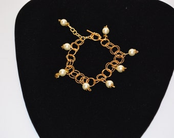 Bracelet with gold chain and 8mm pearls. Approximately 7-8 in matching necklaces.