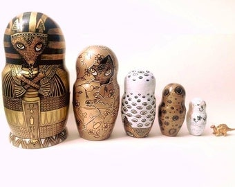 Hand painted russian dolls set with tiny dinosaur