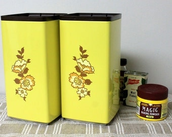 Vintage Yellow Canisters, 2 Tall Tin Kitchen Containers with Floral Design, Brown Plastic Lids Stacking Canisters, 1970's Storage Containers