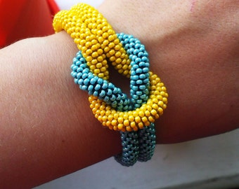 Yellow and blue bracelet with a knot in the colors of Ukrainian flag