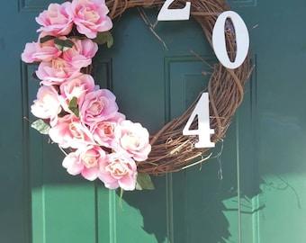 Floral door address wreath with clear hanger