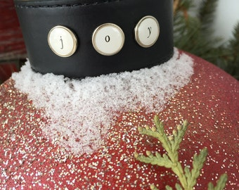 Black leather cuff with JOY