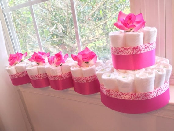 Pink floral baby shower diaper cake centerpieces diapers for for Pink diaper bouquet