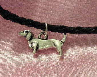 Dachshund / sausage dog lovers charm on a black leather necklace