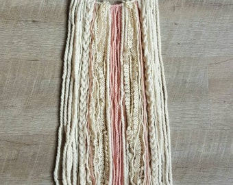 Jae Dream wall hanging, ivory and pink yarns