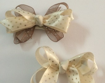 "Set of coordinating 4"" hair bows."