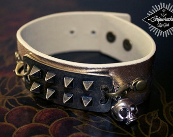 Gold, leather, cuff bracelet, with studded connector and skull charm