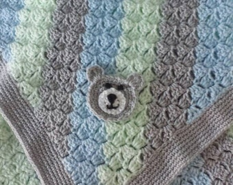 Crochet baby blanket with teddy bear applique