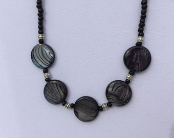 Black Flat Coin Necklace with Silver Plated Heart Toggle Closure.