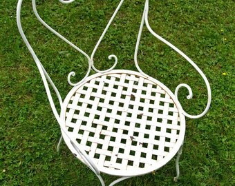 Antique white metal garden chair