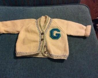 Handmade woollen baby cardigan