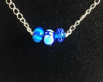 Three blue beads pendant