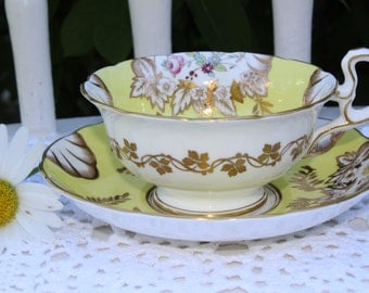 Fenton: Beautiful footed yellow cup and saucer