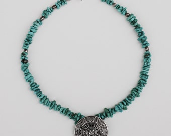 Turquoise Necklace With Silver Tone Focal Piece.