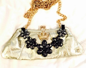 Gold clutch with crown and flowers
