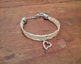 Bracelet with heart charm beige horsehair