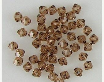 40% CLEARANCE 48 4mm Swarovski crystal bicone 5301 Lt Smoked Topaz 7880