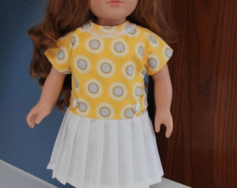 Yellow dress with white pleated skirt