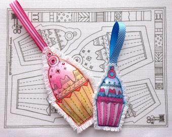 Hand sewn cupcake pattern. Two cake ornament, decoration.