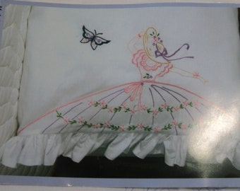 Pillow cases with ruffled edges to be embroidered lady with full skirt design