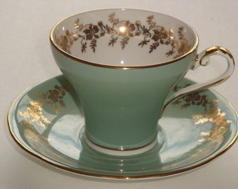 Aynsley Gold on Turquoise Cup and Saucer ~ C2354
