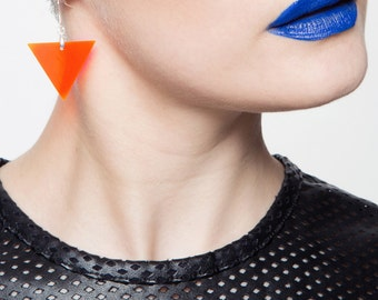 Lucite neon orange earrings, minimal perspex dangles.