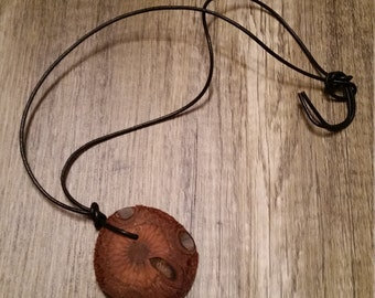Necklace with a piece of wood