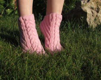Women knitting pink socks slippers