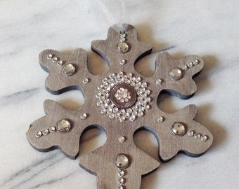 Rustic wood snowflake ornament with jeweled embellishments and tulle hanger