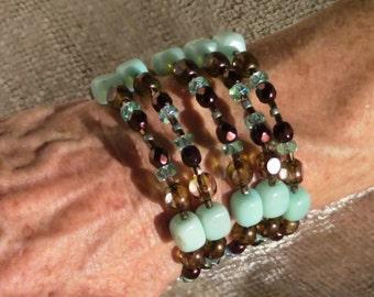 Four strand coil bracelet.