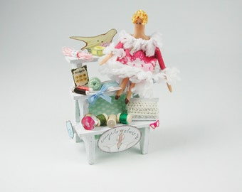 Dollhouse miniatures, staircase decorated with small doll, cushions, tags for the doll in the scale of 1zu12
