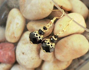 Black and gold vintage drop earrings.