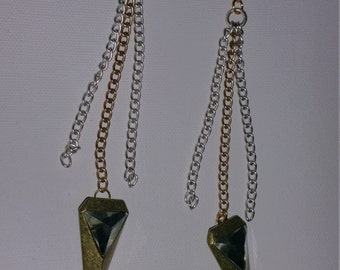 Chic chained gold and silver earrings. Long chains with spear detail.
