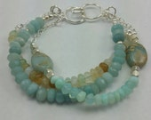 Peruvian opal, blue opal and pacific opal 3 strand bracelet. 7 inches