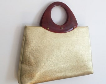 60's gold oversized clutch