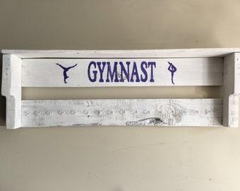 trophy and metal display shelf for gymnast/runner/swimmer etc