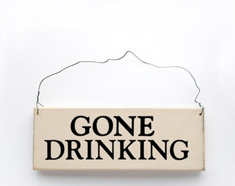 Wood sign saying: Gone Drinking