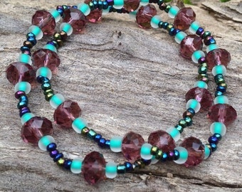 Plum and turquoise beaded bracelet with iridescent accents