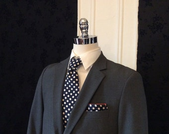 Navy and white polka dot necktie with pocket square