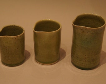 Group of pourers in green stoneware
