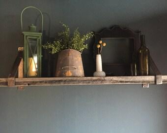 Barnwood shelves with industrial metal brackets