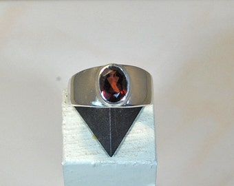 Sterling silver ring with garnet setting