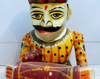Wooden dhola maru  musician with indian traditional art .
