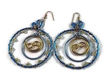 hoop earrings in transparent blue and gold swarovski pearls