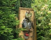 Armed garden owl