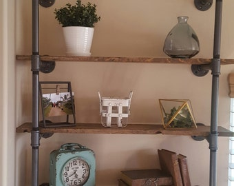 Industrial Pipe Shelving With Distressed Wood Planks