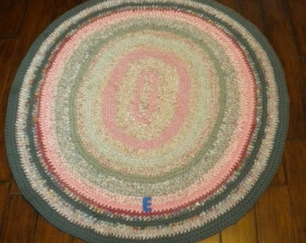 Hand-made, Knotted-style oval rug, using recycled cotton fabric.Sometimes called rag rug. Price reduced by 1/3. Ship to USA address 25.00