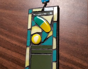Turquoise and yellow stained glass with fused glass and mirror accented mosaic